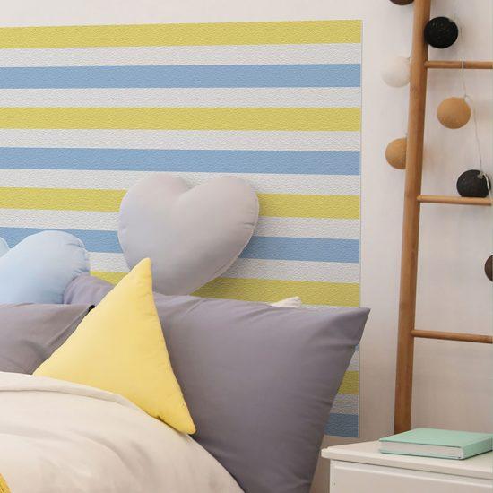 Detalle cabecero de cama de vinilo infantil Rayado Azul y Amarillo