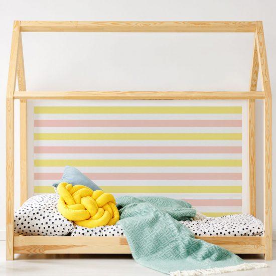 Cabecero de cama de vinilo Infantil Rayado Amarillo y Rosa detalle cama